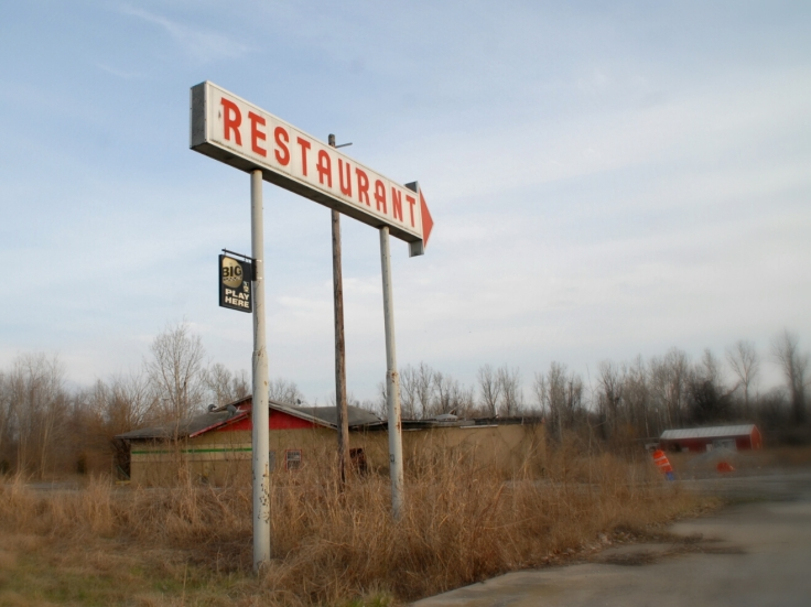 Restaurant Sign over ruins