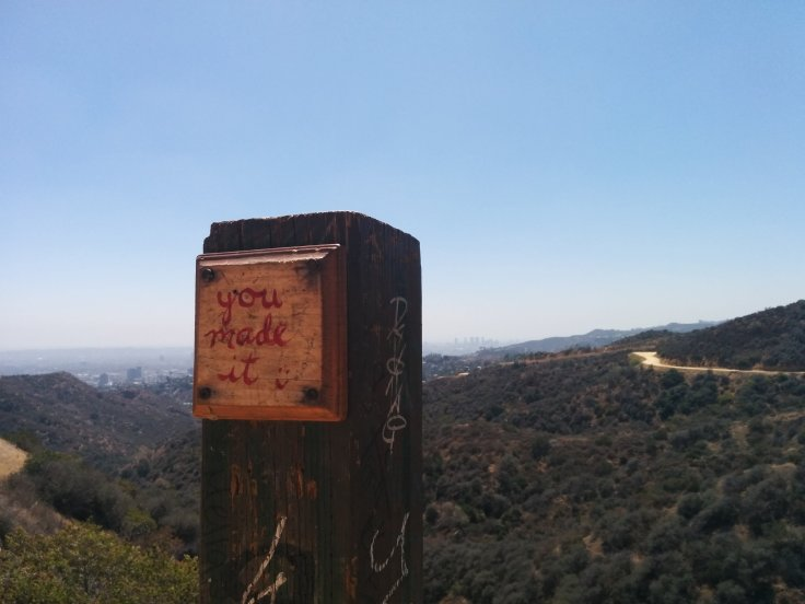 """You made it"" written on a post, mid hike. Did I? Really?"